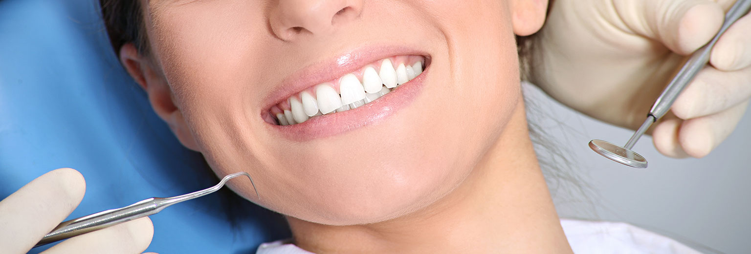 Patient having a teeth whitening